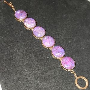 Copper bracelet with purple turquoise.